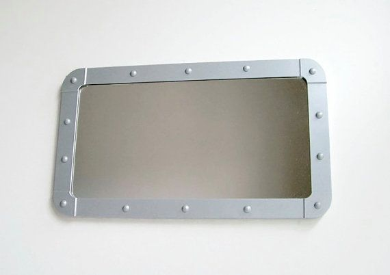 Industrial Porthole Mirror, Metal Mirror, Aluminium Mirror, Bathroom Mirror, Wall Mirror, Handmade Mirror, Reclaimed, Decorative Wall Mirror  An industrial aluminium porthole style mirror that would make an eye catching bathroom mirror. Handmade by me in my Cornish workshop from reclaimed materials. Fitted with two aluminium keyhole fittings on the reverse so it is ready to hang in your home in either portrait or landscape.  The mirror measures approx. 17.25 (440mm) long 10 (255mm) tall and…