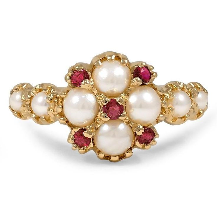 The Silva Ring, top view This 14K yellow gold Edwardian piece features five natural rubies and four cultured white pearls. Pearls grace the shoulders for a truly timeless look (Ruby approx. 0.20 total carat weight).