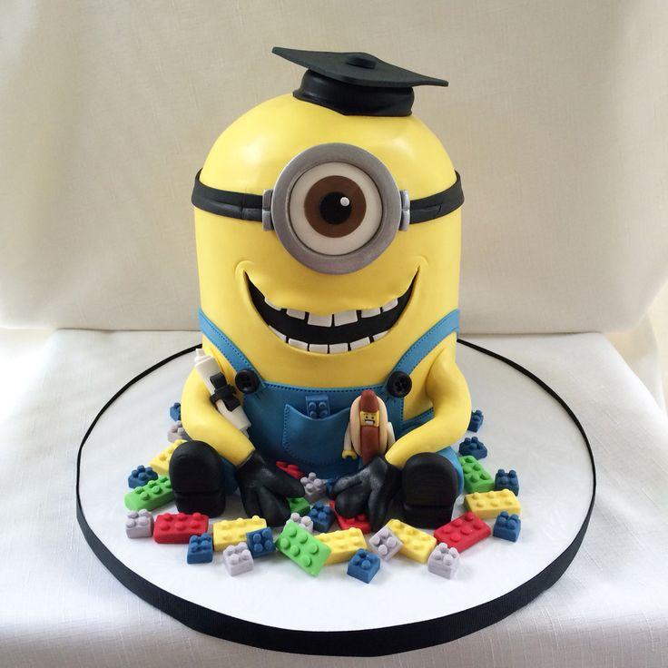 Minion playing with Legos graduation cake