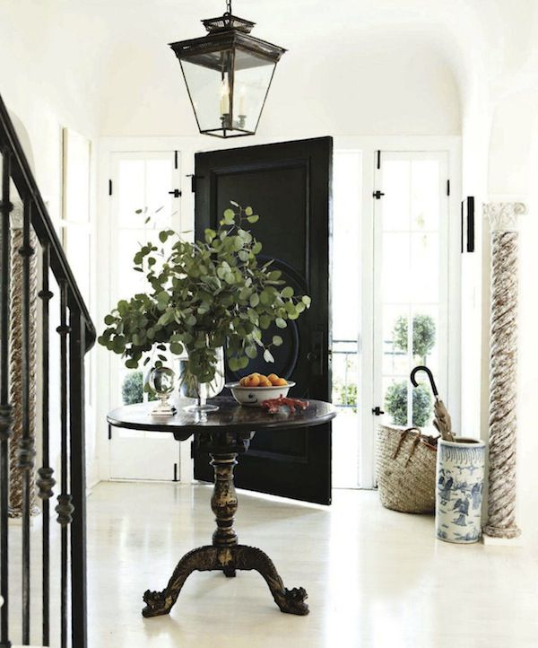 foyer: Entry Tables, Houses Beautiful, Black Interiors, Black Doors, Black Front Doors, Round Tables, Homes, Entry Hall, Entryway