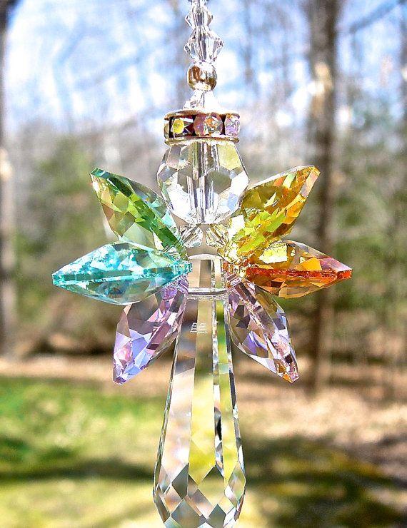 Hey, I found this really awesome Etsy listing at https://www.etsy.com/listing/185007493/swarovski-crystal-angel-suncatcher