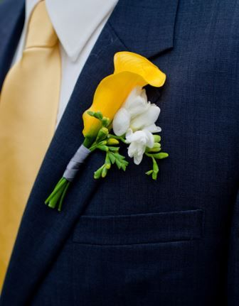 yellow lily and white freesias wedding flower boutonniere, groom boutonniere, groom flowers, add pic source on comment and we will update it. www.myfloweraffair.com can create this beautiful wedding flower look.