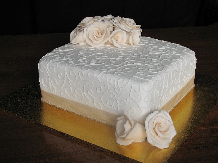 Square Wedding Cake. Chocolate mudcake with apricot roses on white and detailed piping. Check out my page at www.facebook.com/cakesbyleannerhodes