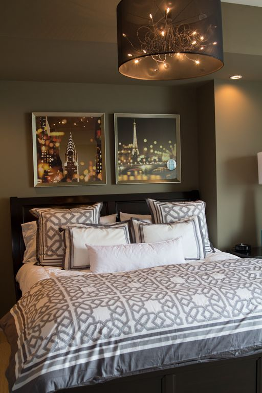 this bedrooms chandelier reflects the pair of cityscape photos that serve as overhead display - Recessed Panel Bedroom 2015