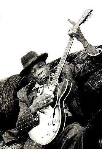 John Lee Hooker, August 22, 1917 – June 21, 2001 was a highly influential blues singer, songwriter and guitarist. Hooker was born in Mississippi, the son of a sharecropper, and rose to prominence performing his own interpretation of what was originally a unique style of country blues. He developed a 'talking blues' style that became his trademark. Though similar to the early Delta blues, his music was metrically free.