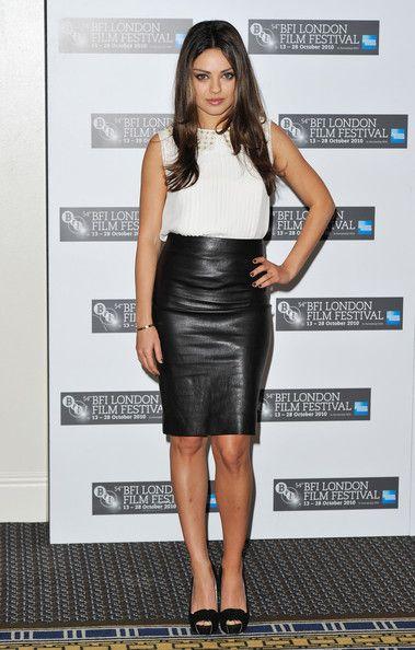 L'Wren Scott white, sleeve-less blouse tucked into knee-length black leather skirt