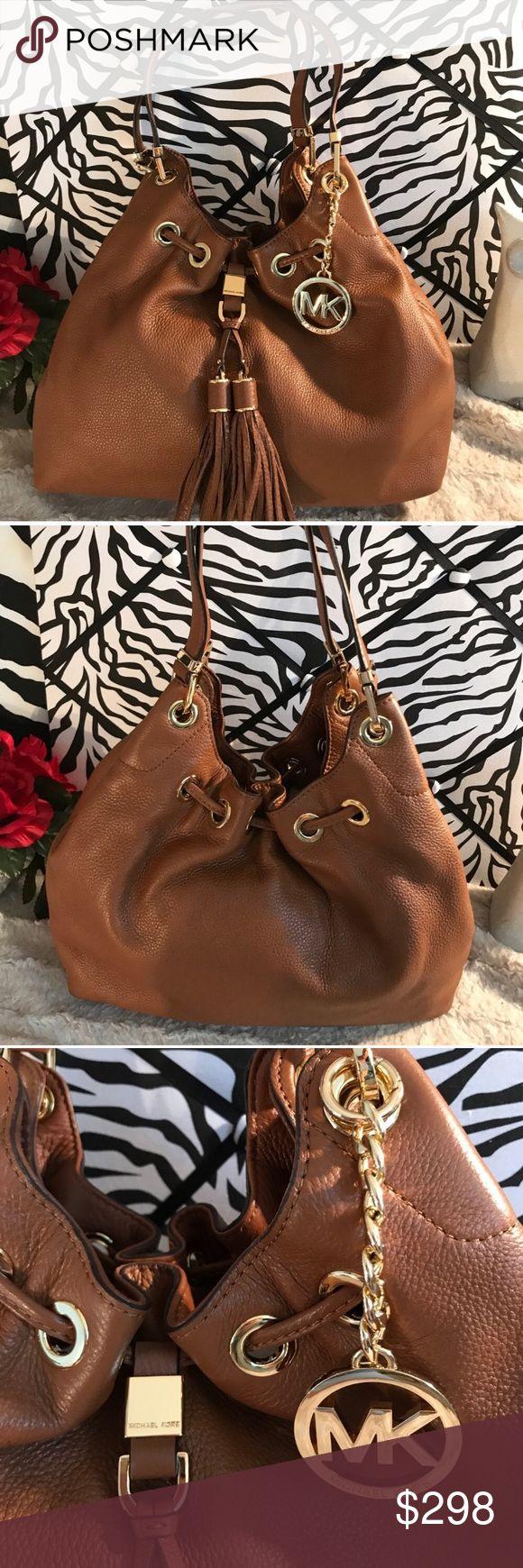 NWOT Michael Kors bag NWOT Brown leather Michael Kors bag. TV is retail value. MICHAEL Michael Kors Bags