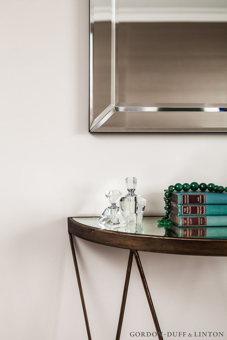 Detail of console table and mirror in master bedroom