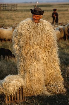 A shepherd wears a coat known as a suba.  Location:	Hortobagy National Park, Hortobagy Plain, Hungary.