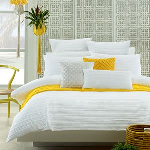 Pure white bed linen, complemented with a pop of yellow, will rejuvenate and refurbish a bedroom with flair, elegance and style. #bed #bedroom #yellow
