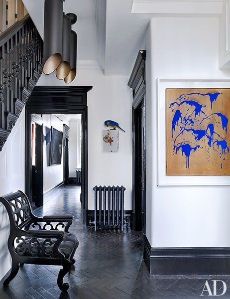 Pieces by Bertozzi & Casoni and Yves Klein enliven a hallway | archdigest.com