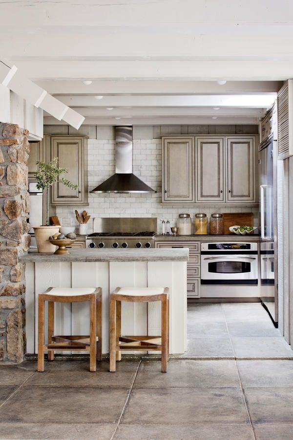 Nature-Inspired Lake House Kitchen - 110 Beautiful Kitchens - Southernliving. Hand-poured concrete countertops pick up the floor's gray tones in this kitchen designed by owner and Southern Living style director Heather Chadduck Hillegas.  See more of this Nature-Inspired Lake House