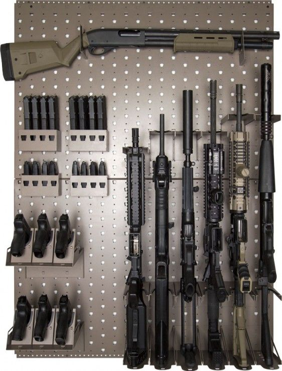 "Rhino Vault Gun Rack. Wayne: I don't even own ""a"" gun, let alone many guns, that would necessitate an entire rack."