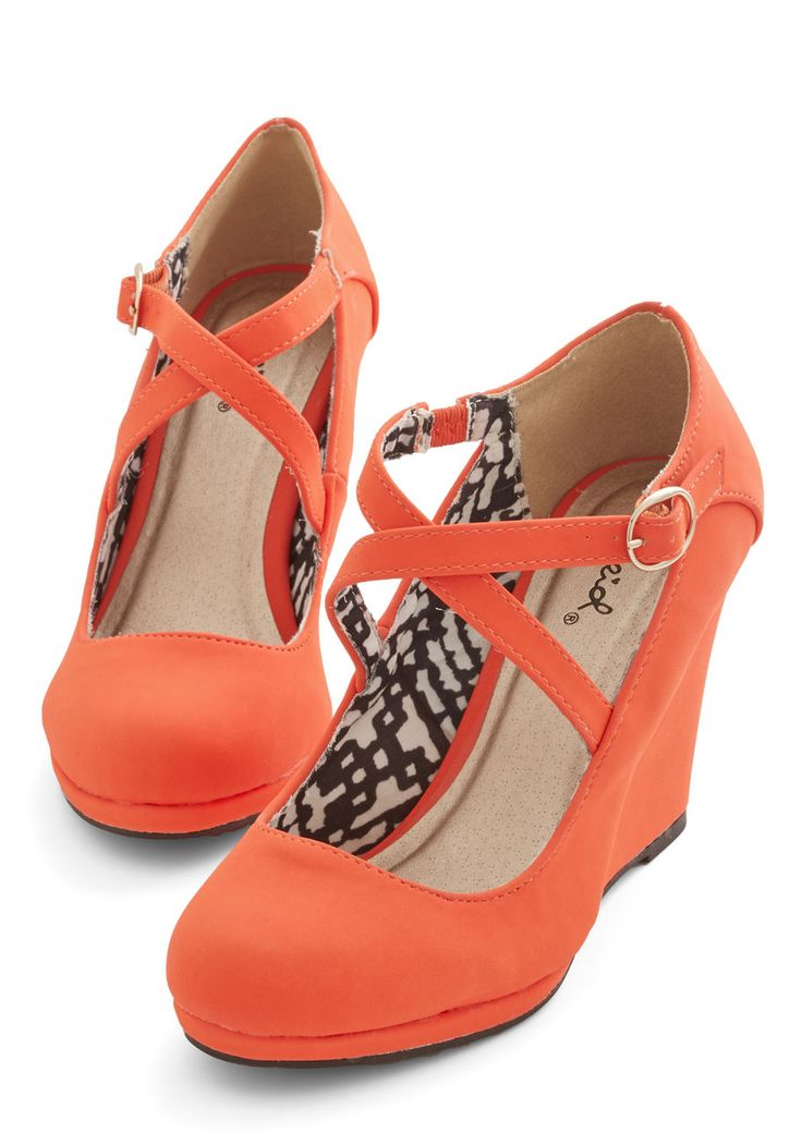 Radiant Reality Wedge. No need to click the heels of these crisscross-strapped wedges! #orange #modcloth