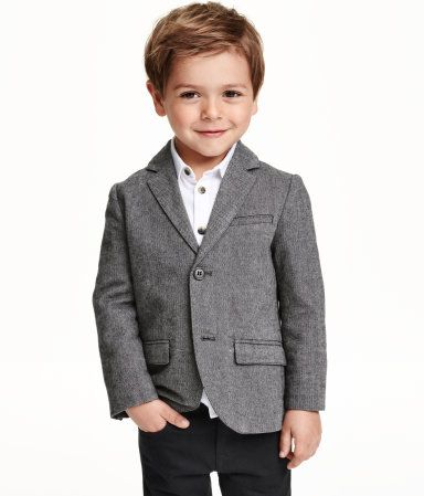 Blazer in a melange cotton blend with contrasting elbow patches. Chest pocket, welt pockets at front with flap, decorative buttons at cuffs, and back vent. Lined.