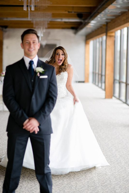The first time you see each other on your wedding day is a magical moment. This is such a sweet photo of the bride during this couple's first look. | A'BULAE in Minneapolis, MN