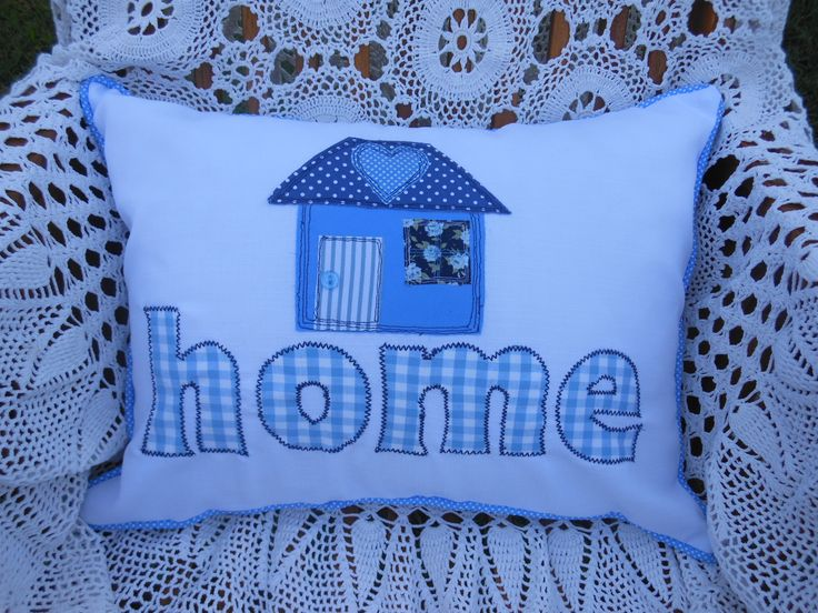 """Tried out some """"free motion"""" sewing on the little house on this cushion."""