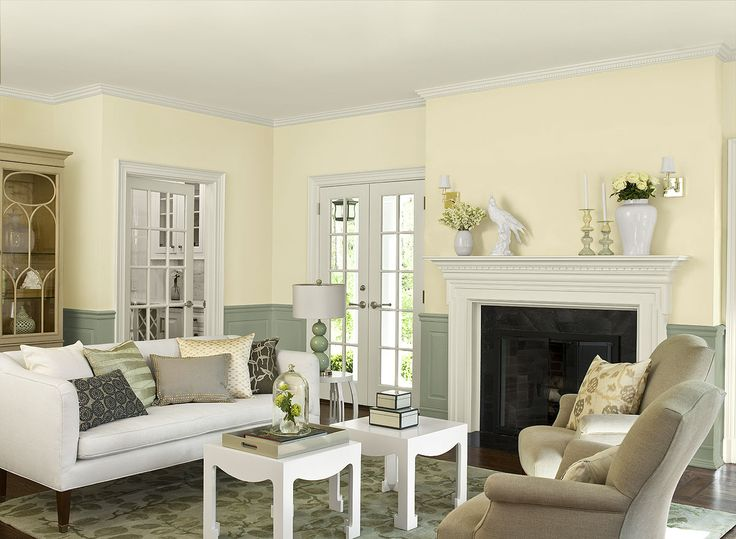 Benjamin Moore Paint Colors - Yellow Living Room Ideas - Soothing, Stylish Yellow Living Room - Paint Color Schemes . . . . . Pair yellow with a pop of Flora (AF-470) green to highlight striking architectural features. . . . . Walls - Antiquity (OC-107); Ceiling, Trim,  Fireplace Mantel - Timid White (OC-39); Wainscoting - Flora (AF-470).