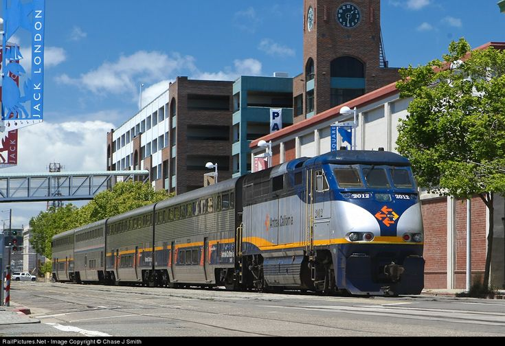 An Emeryville bound Amtrak California train moves through Jack London Square, Oakland, California. Canon EOS 1D Mark III, Canon EF 24-70mm f/2.8L USM