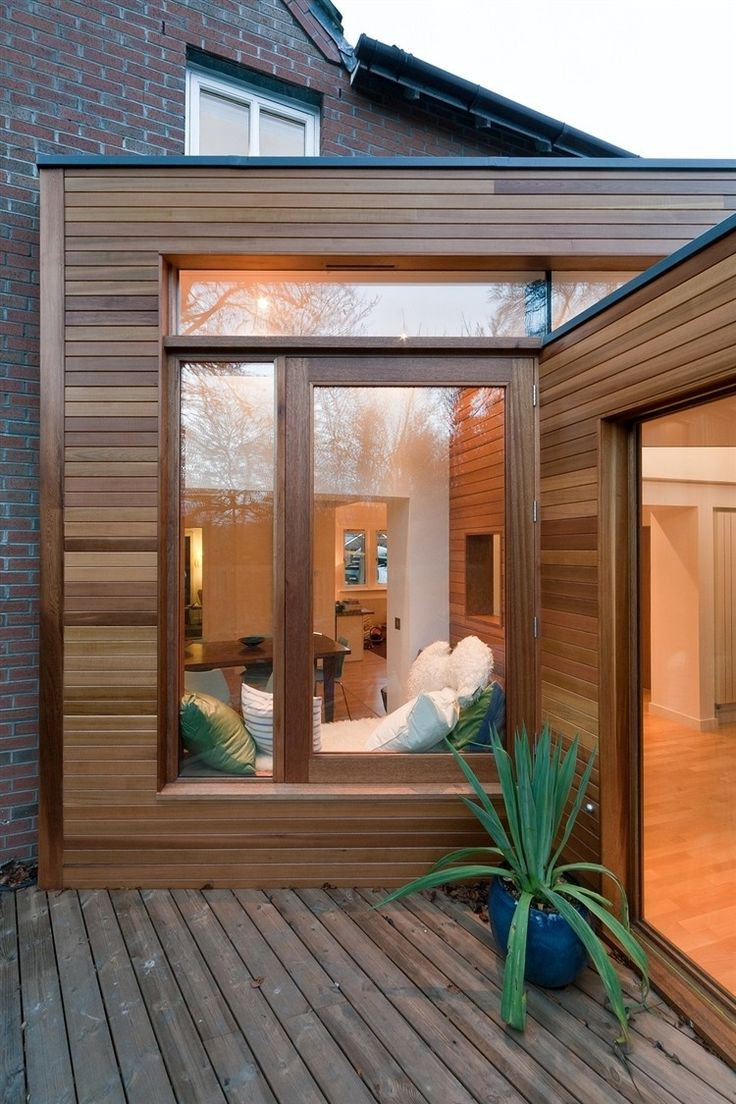 I quite like this 'all wood' look - cedar cladding with timber doors