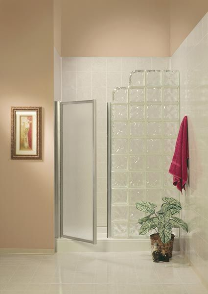 Glass Block wall with a glass door or could have no door as long as the shower head was at the glass block end.