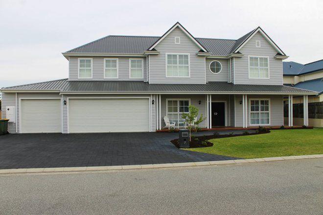 Hampton's style house facade finished; half strength flooded gum, surf mist garage doors.
