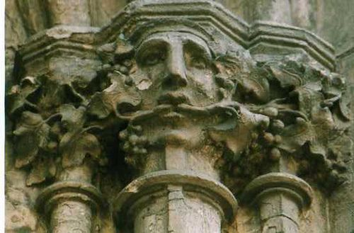 Green Man. Composite stone capital in gothic style. The Green Man is a god or spirit of vegetation and plant growth, especially that of springtime. He is frequently found carved into medieval churches, with his face made from foliage or with leaves sprouting from his mouth.