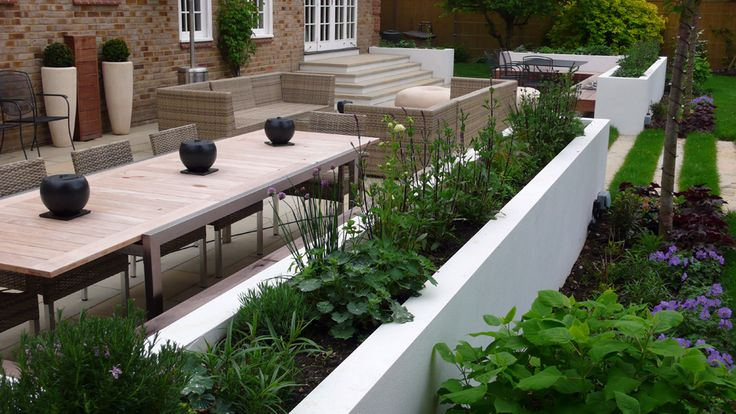 Contemporary outdoor lounge/living area with rattan sofas by Sara-Jane Rothwell