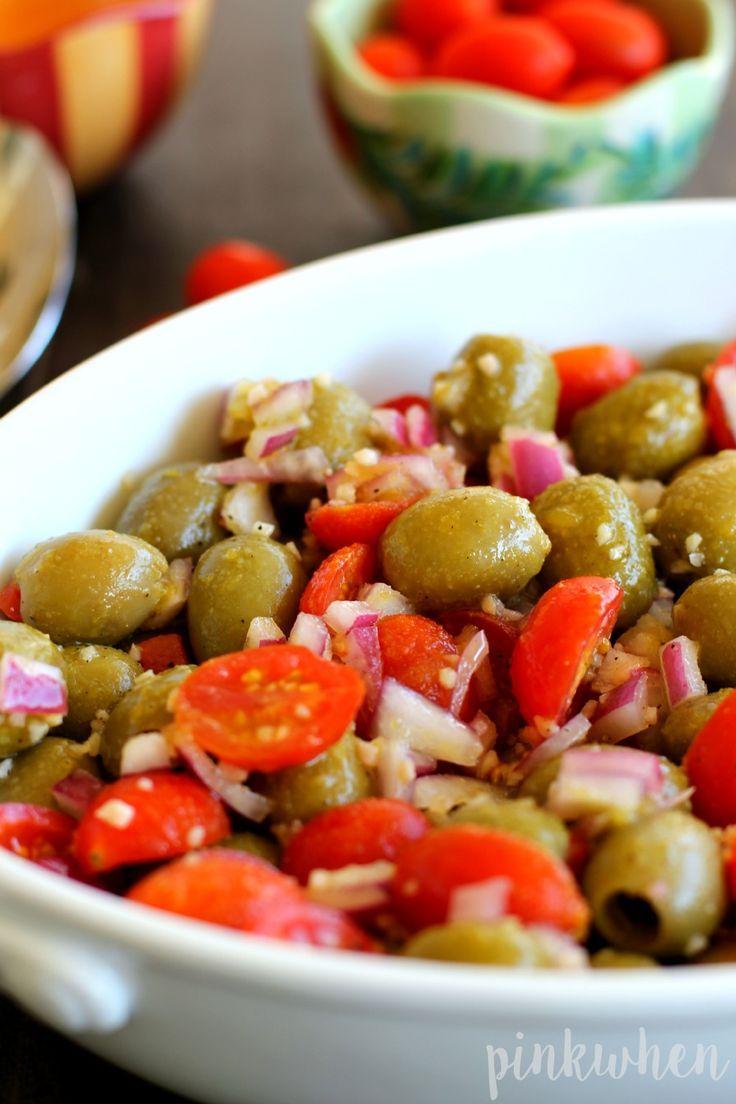 Marinated Olive and Grape Tomato Salad   this looks amazing