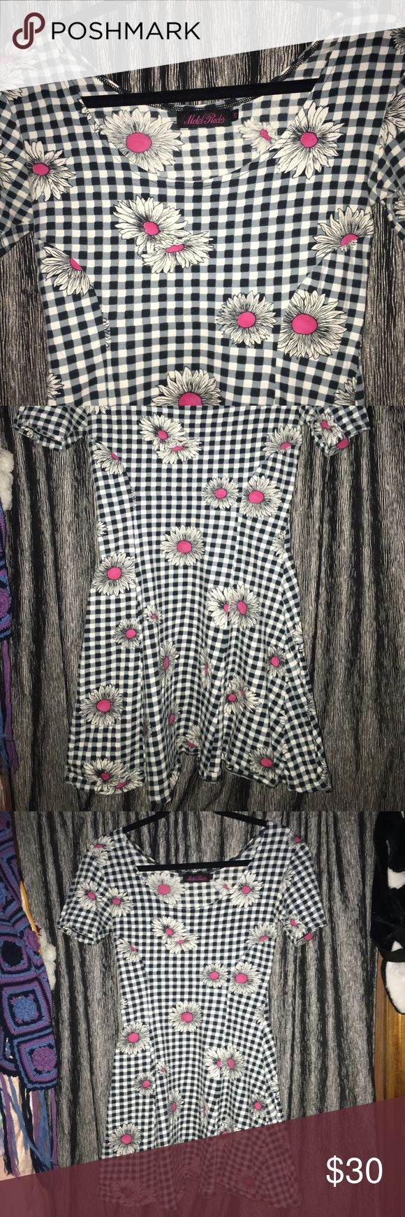 ✨Checkered Daisy Dress✨ This is so freaking cute! I purchased this used from EBay and just never wore it. I'm not a fan of the pink on the daisies, that's really the only reason I never wore it. It's in beautiful previously loved/used condition. It is the cutest little dress ever when it's on! ✨ any questions, please ask. Pet friendly smoke free home!💖 Motel Rocks Dresses