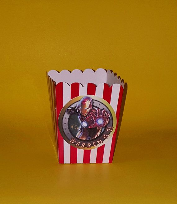 Iron Man Popcorn Boxes  These mini popcorn boxes will look amazing on your treat table! Fill with popcorn, chips, candy or other snacks for your guest to enjoy or pre-wrap your treats with cellophane and gift as a small favor! Perfect for an Avengers theme birthday party. D E S I G N: Mini Popcorn Boxes - Red, Gold, Black  P E R S O N A L I Z A T I O N: Please include personalized name and age in checkout comments. If not in comments, boxes will come without personalization. I N C L U D E S…