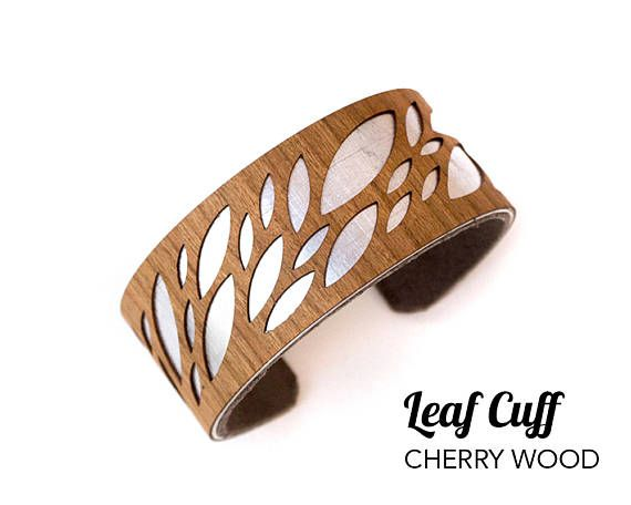 Our narrow cuff bracelets are made from hand brushed aluminum and rich cherry or walnut wood. The contrast of metal and wood is striking and makes a beautiful and simple statement piece. Theyre very lightweight and comfortable to wear. Easy to put on with your favorite jeans, or dressed up