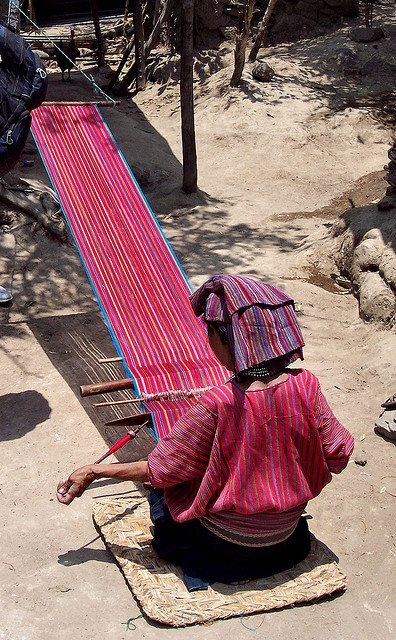 Mayan woman in the high country of Guatemala at her loom