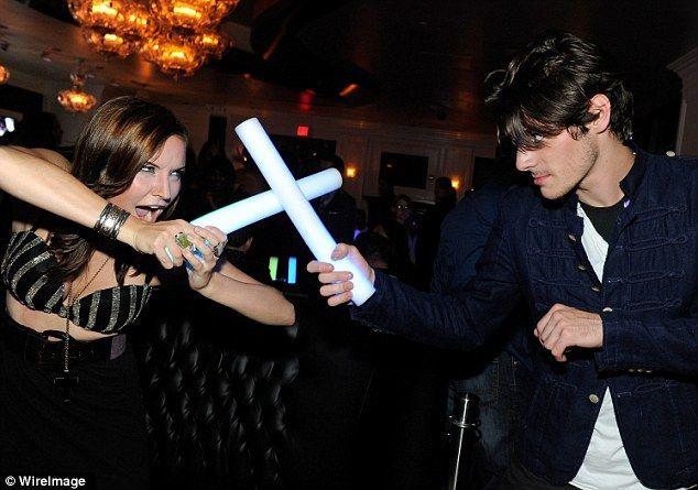 "RJ Mitte of Breaking Bad fame enjoys a play ""lightsaber"" battle with Lindsey Haun of True Blood. Walter White Jr. a.k.a. Flynn, makin' me proud."