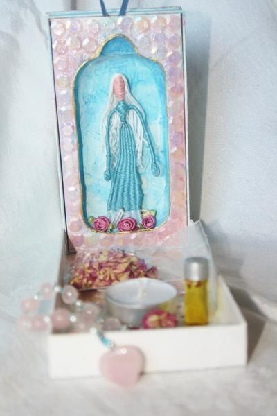 Hand made altar box include an artistic rendition of the Blessed Mother, a tea light, anointing oil, rose petals, rosary beads of rose quartz…