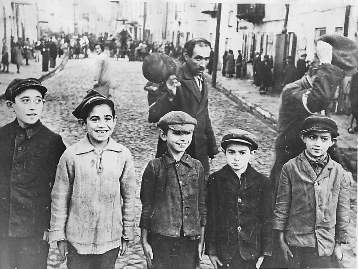 A group of Jewish children in the Jewish section of Lublin, Poland, a press photo of 1940
