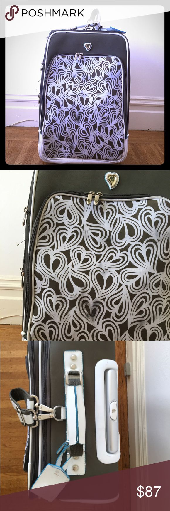 DVF Large Roller Bag This bag was used only a few times.  Green and white heart pattern stands out on baggage carousel. Expandable zip section if squeezing everything in isn't cutting it. Some markings on the front from being checked, may wash out. Lockable zippers - Single top telescoping handle - Zip around closure - Exterior features zip extension, heart jacquard construction, 4 wheels, and front zip pocket - Interior features 2 zip mesh pockets, 1 zip pocket, 2 slip pockets and garment…