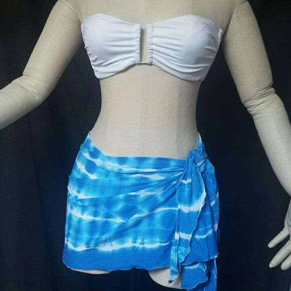 White bandeau bikini top w/surong set White mossimo from target bikini top size small with removable pads and hook eye closeure in back with a o/s fits most blue and white tie dye swim cover up surong. Both gently used and top has some self tanner on the bottom of the breast but nothing that wont wash out. Sorry no bikini bottoms included in set Mossimo Supply Co Swim Bikinis
