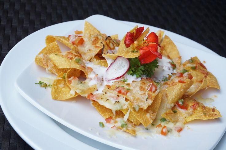 These crispy nachos make a great snack and work well as a meal, too 😋 #J4hotelslegian #J4hotels #LifestyleHotel #Lifestyle #HotelBali #Holiday #InstaTravel #Vacation #LegianBali #Wanderlust #Destination #LegianStreet #RoofTopPool #RoofTopSwimmingPool #Bali #Indonesia #HappyHour #Traveler #Backpacker #HappyLife #LightSnack #Crispy #Nachos #CheeseNachos #Meals #Cheese #Snack #Tasteful #HeartyFood #Delicious