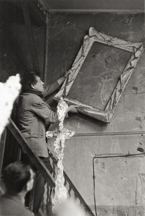 Alberto Giacometti framing his graffiti, Paris. By Inge Morath, 1958.
