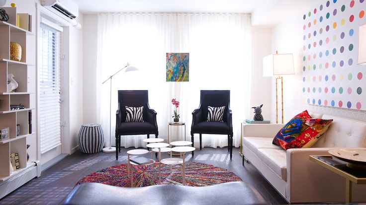 """A visit to the Andy Warhol museum in Pittsburgh last fall was the designer's starting point for this one-bedroom Pop Art inspired unit. Black and white furnishings are paired with vibrant coloured accessories and gold metal accents that will surely appeal to the savvy fashion-forward crowd.   (Built by Brad Remington Homes; Interior Design by ANA Interiors; Photography by Photophilcro). Find this at Copperfield Park III in the """"E2 Showsuite""""."""