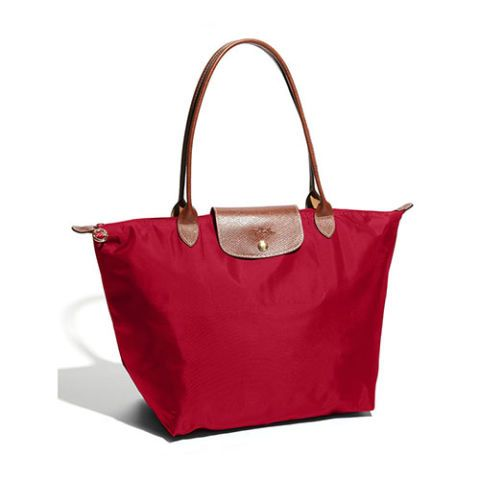 10 Fun Tote Bags We Love - Cute and Colorful Totes for Women - Long Champ Large Le Pliage Tote - $145, nordstrom.com. The Le Pliage has long been a favorite for tote bags. It's perfect for commuting to work or the classroom, and is made from durable nylon with a signature tan leather trim. 12 different color options and multiple sizes make it difficult to choose just one. Discover more statement accessory ideas at redbookmag.com.