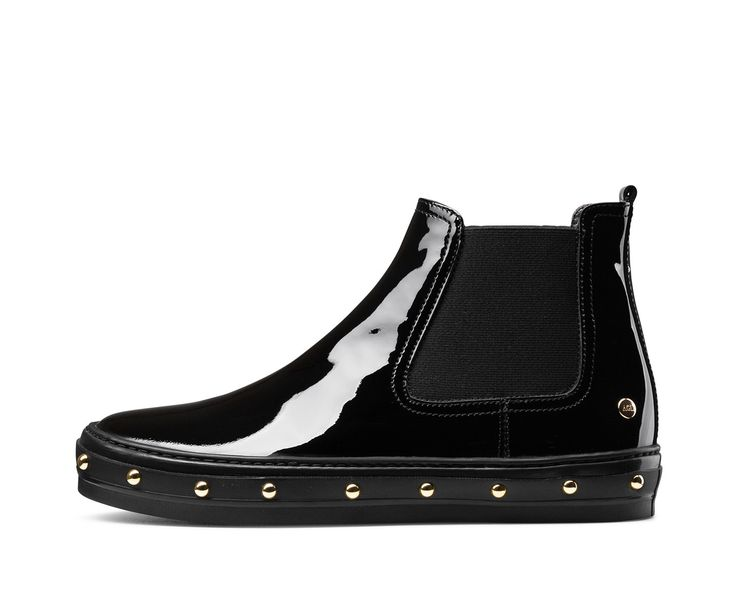 AGL FW16 - STUD - Extremely comfortable sporty chic low boot inspired by skater fashion. Rugged modern look guaranteed by the material it is made of – velour or patent leather – and the decoration on the sole, with the addition of hand-riveted studs.
