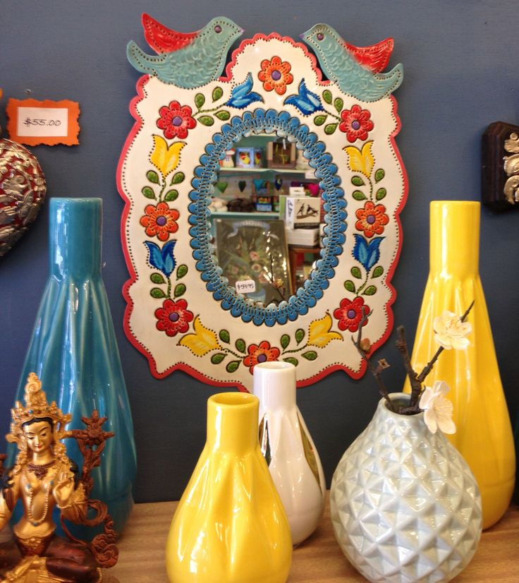 Different textured vases paired with a Mexican tin mirror