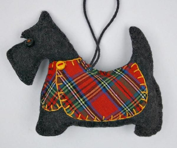 Handmade felt Scottie dog ornament for Christmas or any occasion. Dougal is a Scottish Terrier made from dark grey felt, with a jolly buttoned jacket in red or teal tartan, and a cotton loop for hangi