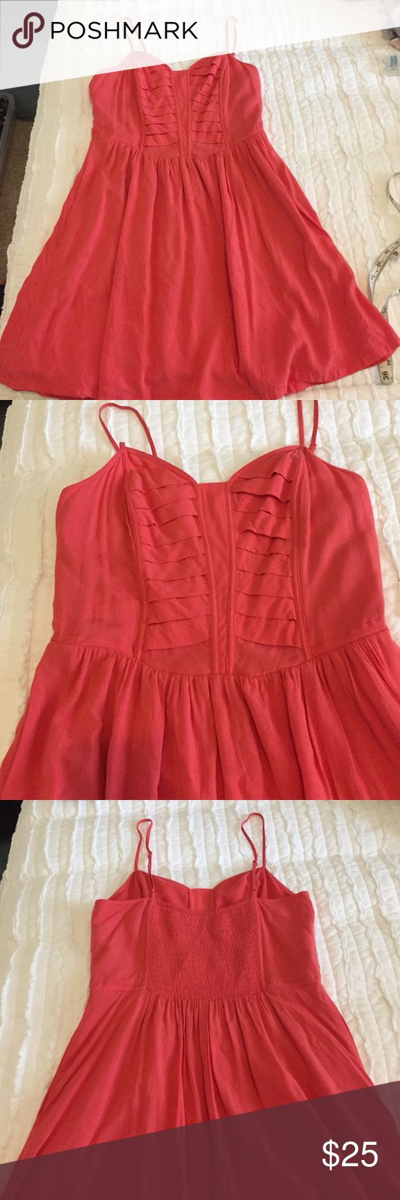 BCBGeneration Dress BCBGeneration coral colored dress. Adjustable straps, pockets, fully lined, fitted bodice for fit and flair fit. Some of the lining inside the bust has pulled away away but it does not affect the The fit or the dresses seeming in anyway. BCBGeneration Dresses