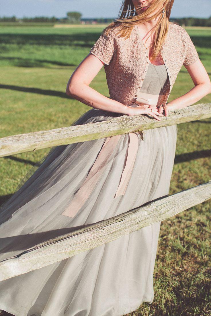 Blush and grey dress.  Metal Flaque Paris. Photography: Chris Spira Photography - chrisspiraweddings.com  Read More: http://www.stylemepretty.com/destination-weddings/2013/12/24/vaucellehof-wedding/
