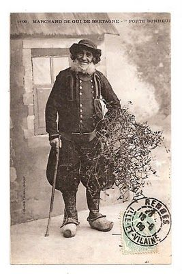 "French photo postcard, ""MARCHAND DE GUI DE BRETAGNE"", Mistletoe Vendor from Brittany, 1908; note the distinctive regional costume with double-breasted, brass buttoned coat, voluminous breeches, and wooden shoes"