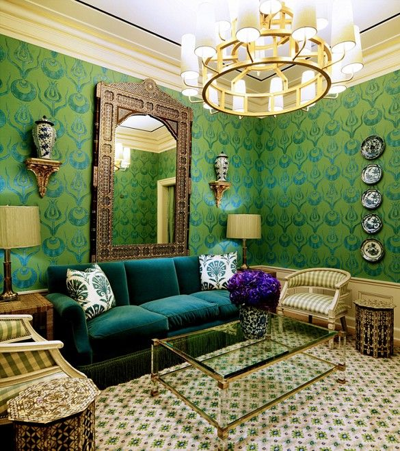 Tory Burch store design with lucite and brass coffee table and wallpapered seating area