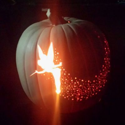 Tinker Bell Pixie Dust Pumpkin Carving - trace Tinker Bell image to pumpkin, cut out; use different drill bits to create pixie dust!
